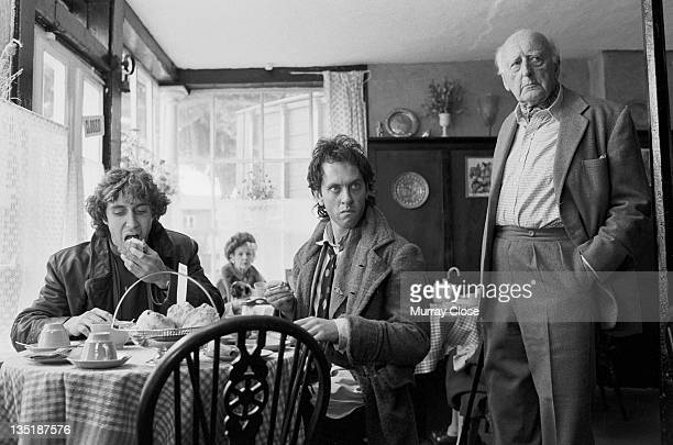 From left to right British actors Paul McGann Richard E Grant and Llewellyn Rees film a scene in Stony Stratford Buckinghamshire for the movie...