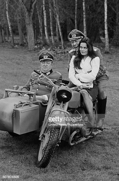 British actors Richard Marner Sam Kelly and Francesca Gonshaw posed astride a motorbike and sidecar in character as Colonel Kurt Von Strohm Captain...