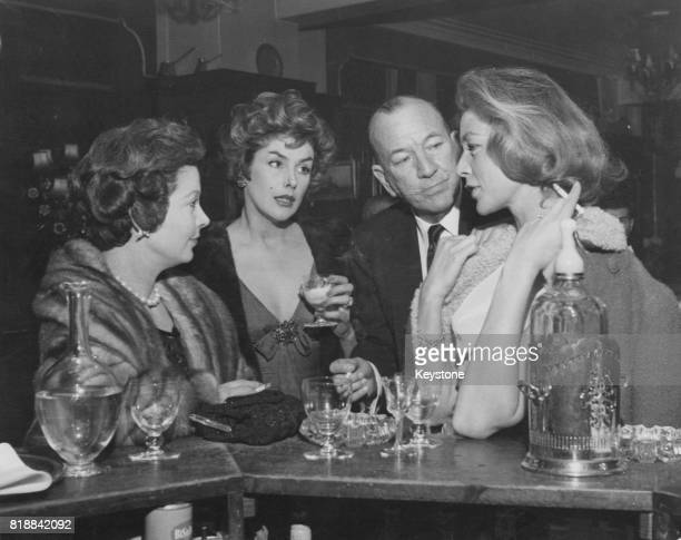 From left to right British actress Vivien Leigh actress Kay Kendall actor Noel Coward and actress Lauren Bacall at St Martin's Theatre in London 29th...