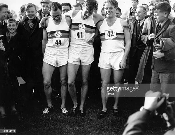 From left to right, British athletes Chris Brasher , Roger Bannister and Chris Chataway after Bannister's record breaking 4 minute mile run in 3 mins...