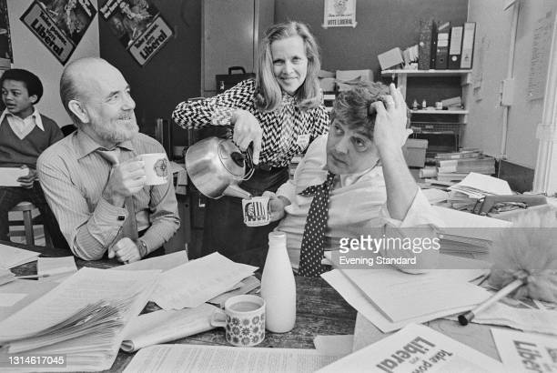 From left to right, British composer and presenter Steve Race with actors Honor Blackman and David Hemmings at the Liberal Party campaign office...