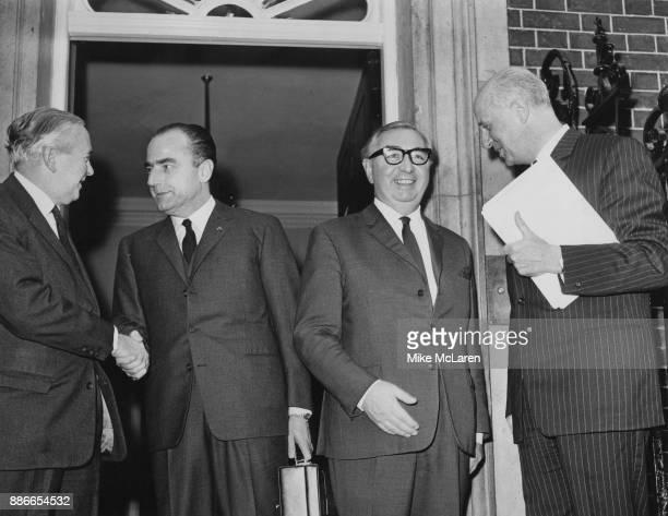 From left to right, British Prime Minister Harold Wilson, Belgian Prime Minister Paul Vanden Boeynants , British Foreign Secretary George Brown and...