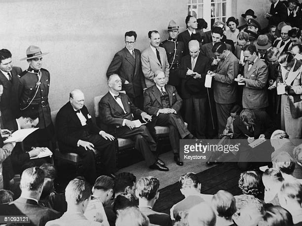 From left to right British Prime Minister Winston Churchill US President Franklin D Roosevelt and Canadian Prime Minister William Lyon MacKenzie King...