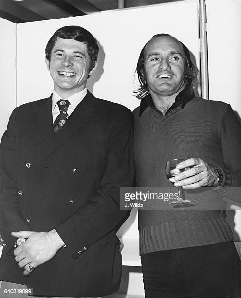 From left to right, British racing drivers David Purley and Mike Hailwood attend a reception aboard the 'Free Enterprise II' at the Pool of London,...