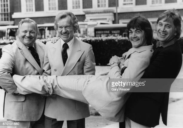 From left to right British singers and musicians Harry Seycombe Bert Weedon and Vince Hill hold up Bobby Crush at the launch of the new record...