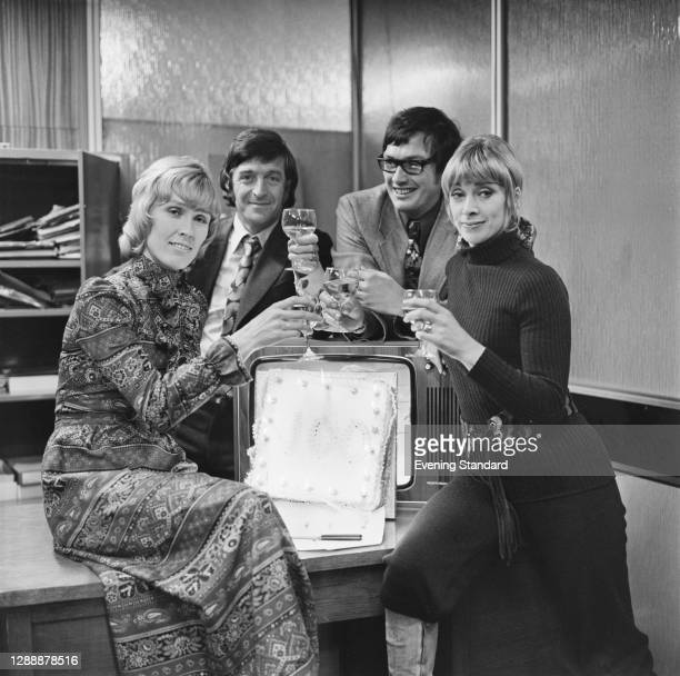 From left to right, British television presenters Mary and Michael Parkinson, Allan Hargreaves and Renny Lister, UK, November 1971.