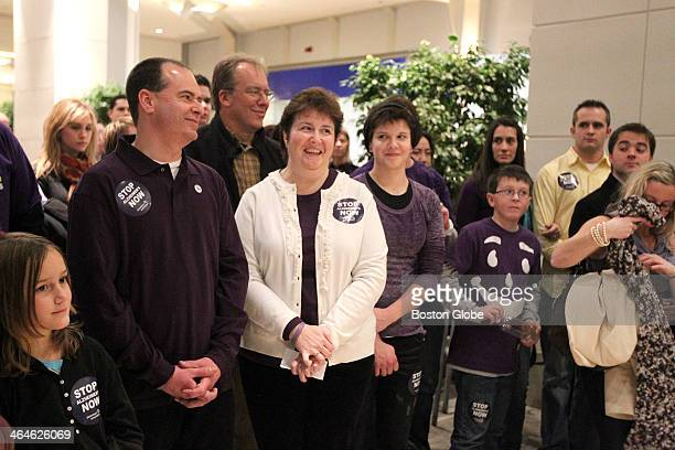 From left to right Bruce Vincent left diagnosed with earlyonset Alzheimer's with wife Cindy Vincent and his family at an Alzheimer's awareness rally...