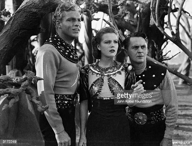 From left to right Buster Crabbe Jean Rogers and Donald Kerr as Flash Dale Arden and Happy Hapgood in episode ten of the scifi sequel 'Flash Gordon's...