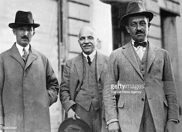 From left to right Captain Sabri Bey liaison officer for Ismet Inonu Pasha Ahmed Thsan of the Turkish Press Bureau and Major Arif Bey aidedecamp of...