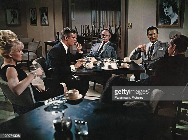 From left to right Carroll Baker George Peppard Martin Balsam Robert Cummings and Alan Ladd star in 'The Carpetbaggers' 1964