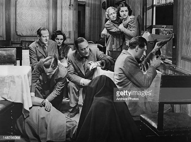 From left to right, Cecil Parker, Naunton Wayne , Linden Travers, Basil Radford, Dame May Whitty, Margaret Lockwood and Michael Redgrave are pinned...