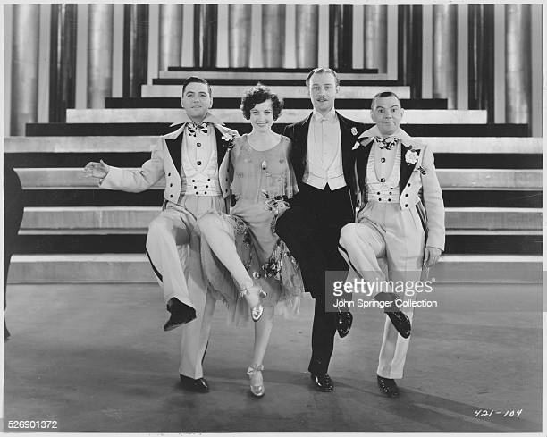 Charles King, Joan Crawford, Conrad Nagel, and Cliff Edwards dance in The Hollywood Revue of 1929.