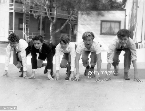 From left to right child actors Kenneth Wilson Freddie Bartholomew Billy Burrud Mickey Rooney and Jay Ward racing in the yard of the MGM schoolhouse...