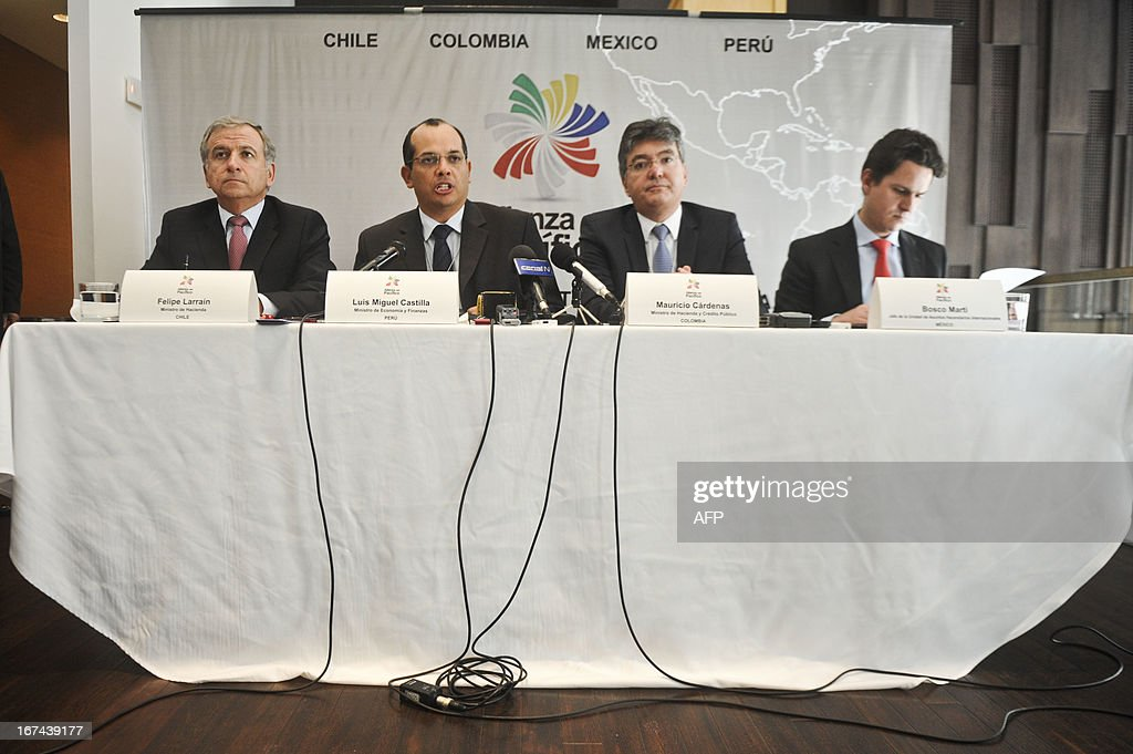 """Chile's Economy Minister Felipe Larrain, Peru' Luis Miguel Castilla, Colombia' Mauricio Cardenas and Mexico' Bosto Marti participate in a press conference during the Eighth World Economic Forum for Latin America in Lima on April 25, 2013. For two days and under the theme """"Delivering Growth, Strengthening Societies"""", more than 600 regional and global leaders will discuss the opportunities and challenges that lie ahead to achieve the region's full potential."""