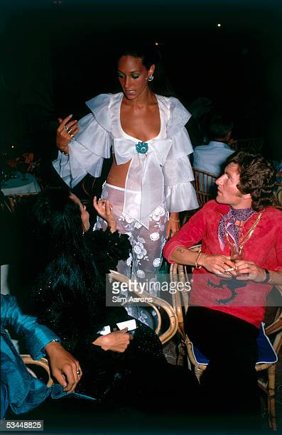 From left to right China Mochado actress Marisa Berenson and photographer Lord Patrick Lichfield on Capri 1968