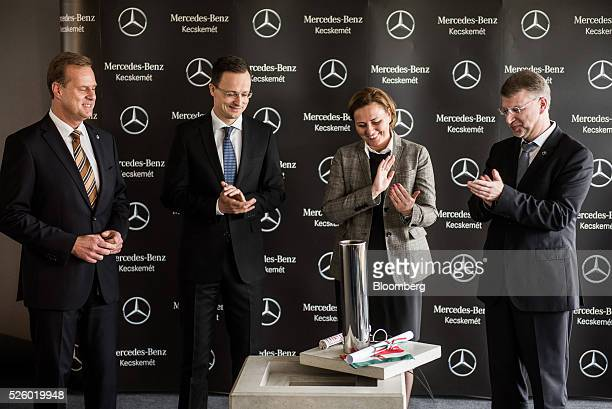 From left to right, Christian Wolf, chief executive officer of Mercedes-Benz Manufacturing Hungary kft, Peter Szijjarto, Hungary's minister of...