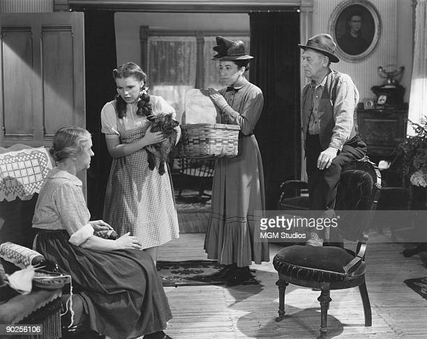 From left to right, Clara Blandick, Judy Garland, Margaret Hamilton and Charley Grapewin star in the MGM film 'The Wizard of Oz', 1939. In this...