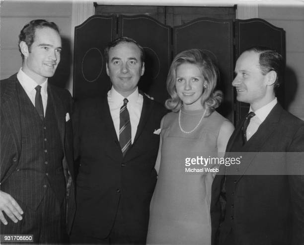 From left to right Clive Carr Rupert Murdoch and his wife Anna and William Carr during a meeting of 'News of the World' shareholders in London 2nd...