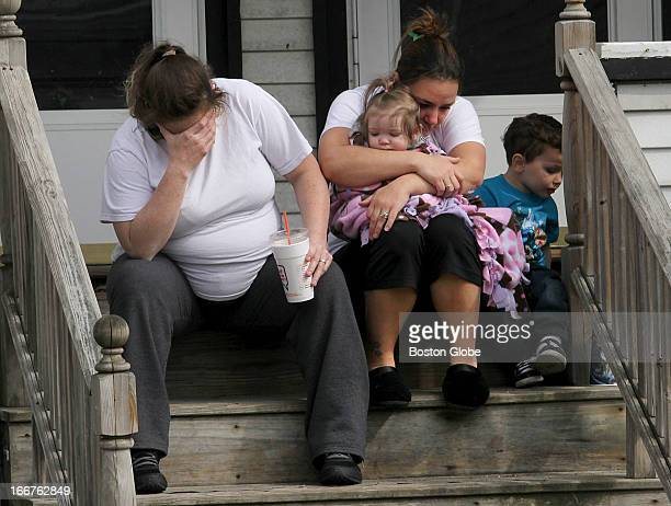 From left to right: Colleen Howe and Lisa O'Leary grieve for their neighbors loss of her daughter on their shared front porch. Patty Campbell lost...