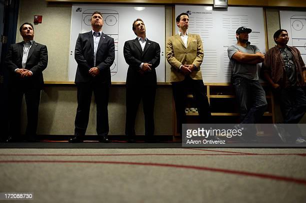From left to right Colorado Avalanche head coach Patrick Roy executive director of hockey operations Joe Sakic and president Josh Kronke listen...