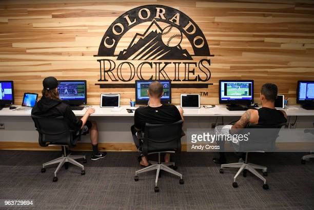 From left to right Colorado Rockies center fielder Charlie Blackmon left closing pitcher Wade Davis and first baseman Ian Desmond look over previous...