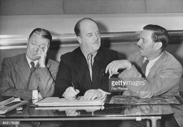 From left to right comedian Tommy Handley writer Ted Kavanagh and producer and former cricketer Francis Worsley who are collaborating on the BBC...