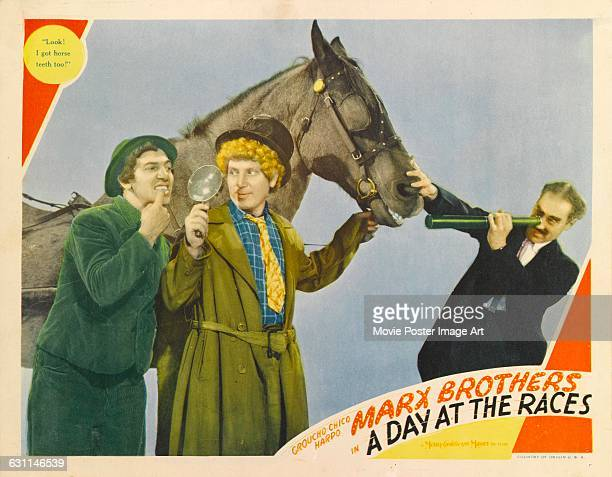 From left to right comic actors Chico Harpo and Groucho Marx star in the 1937 Marx Brothers comedy 'A Day at the Races' directed by Sam Wood for MGM