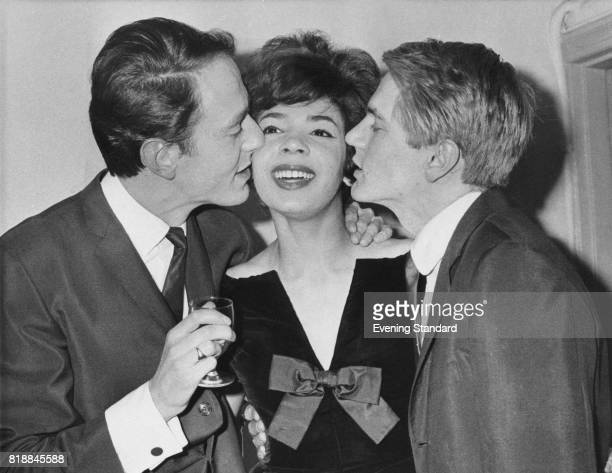 From left to right composer John Barry and singers Shirley Bassey and Adam Faith at one of Faith's parties London UK January 1961