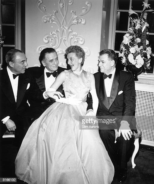 From left to right composer Richard Rodgers producer Leland Hayward actress Mary Martin and songwriter Oscar Hammerstein attend a party to celebrate...
