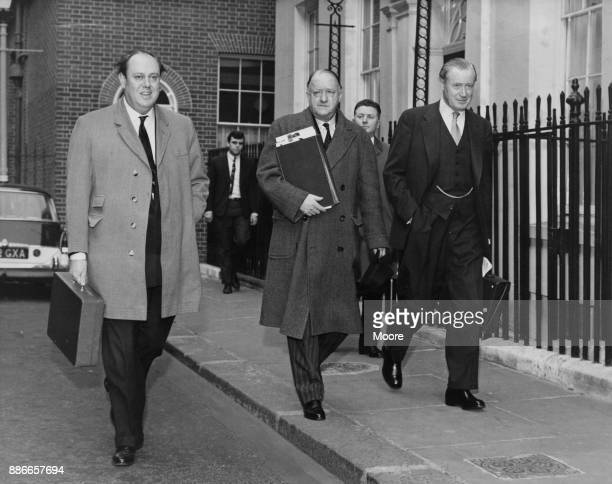 From left to right Conservative cabinet ministers Christopher Soames Rab Butler and Duncan Sandys make their way to 10 Downing Street on polling day...