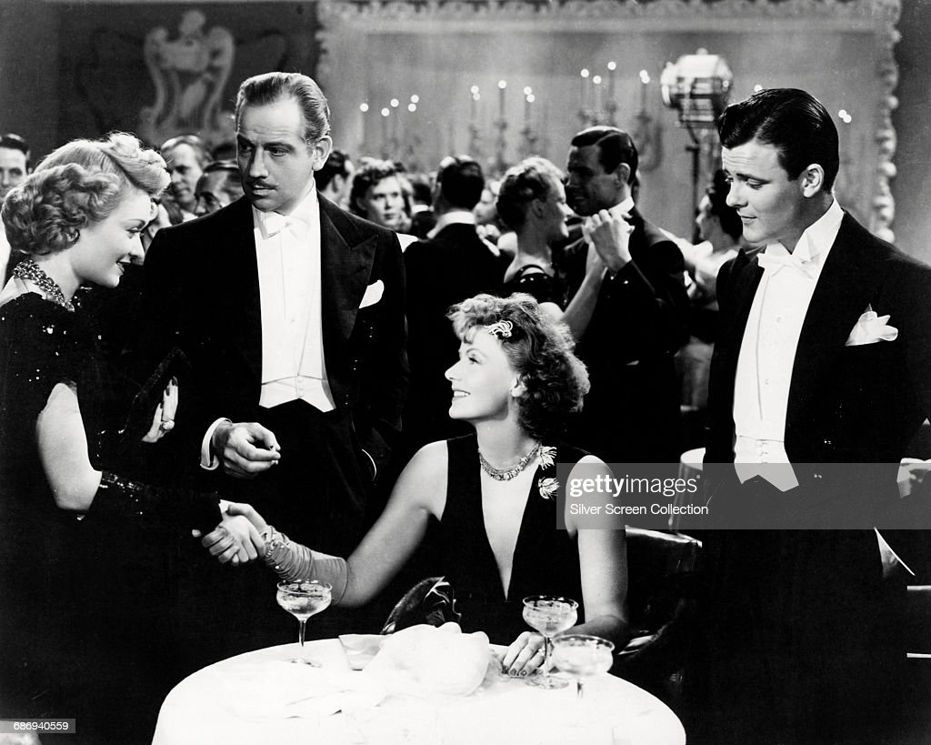 From left to right, Constance Bennett as Griselda Vaughn, Melvyn Douglas as Larry Blake, Greta Garbo as Karin Borg Blake and Robert Sterling as Dick Williams in a scene from the film 'Two-Faced Woman', 1941.