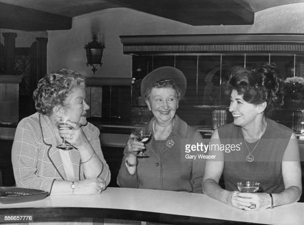 From left to right 'Coronation Street' actresses Violet Carson Margot Bryant and Pat Phoenix take a break during rehearsals for the 'Royal Gala' show...