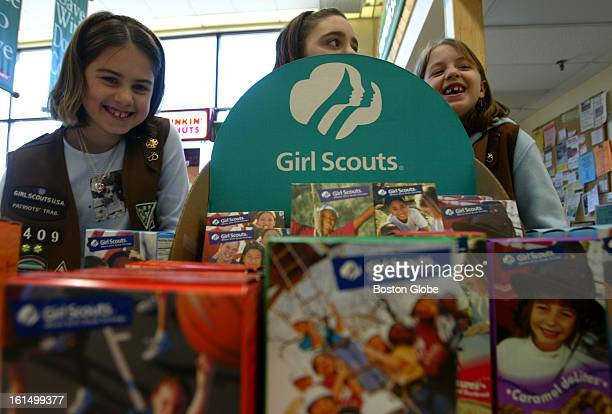 From left to right Cristina Savino Nicole Zeitlin and Kayla Stefanelli from Brownie Troop 1409 laugh while they sell Girl Scout Cookies at the Stop...