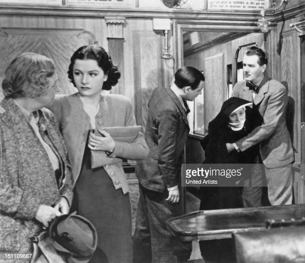 From left to right Dame May Whitty Margaret Lockwood Naunton Wayne Catherine Lacey in a nun costume and Michael Redgrave in a scene from the film...