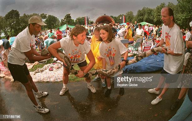 From left to right Daryl Bowden Kathy Rockenhauser Alicia Rockenhauser Felicia Farland and Paul Martin team up to wring water from a blanket after a...