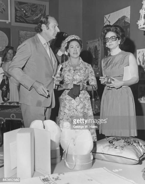 From left to right David OrmsbyGore 5th Baron Harlech Princess Margaret and Lady Harlech attend the Revival of Art in Needlework Exhibition at...