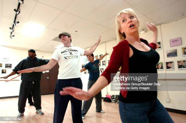 From left to right De Thomas Brian Jackson Choreographer Matthew D Peters and Joanie Brousseau work on some dance move for Boulder's Dinner Theatre...