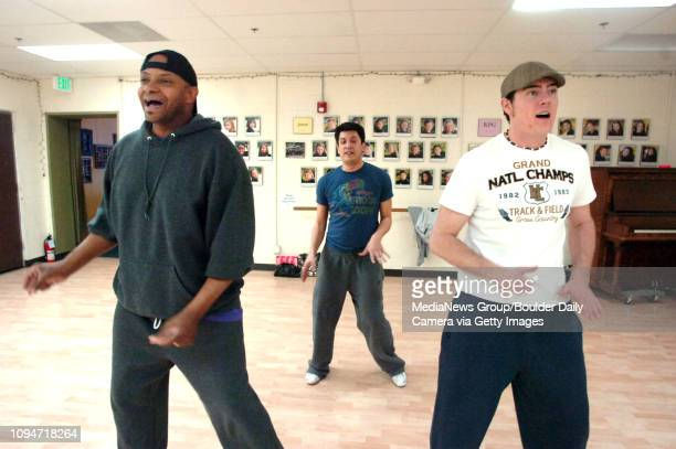 From left to right De Thomas Choreographer Matthew D Peters and Brian Jackson work on some dance move for Boulder's Dinner Theatre production of...