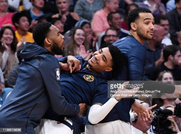 From left to right, Denver Nuggets guard Will Barton , Gary Harris and forward Trey Lyles celebrate a slam dunk by teammate Denver Nuggets forward...
