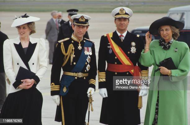 From left to right Diana Princess of Wales and Prince Charles greet King Juan Carlos and Queen Sofia of Spain at Heathrow Airport for a State Visit...