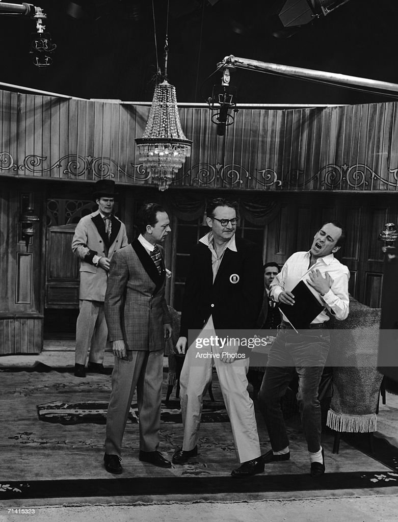From left to right, Don Knotts (1924 - 2006), Steve Allen (1921 - 2000) and Louis Nye (1913 - 2005) film an episode of 'The Steve Allen Show', November 1959. In the background (left) is actor Chuck Connors, a guest on the show.