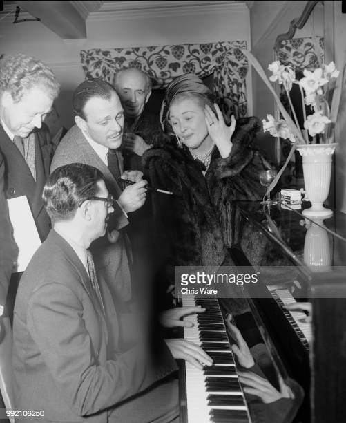From left to right Dr Hubert Clifford musical director for Sir Alexander Korda comic actor TerryThomas producer Victor Skutezky and actress Christine...