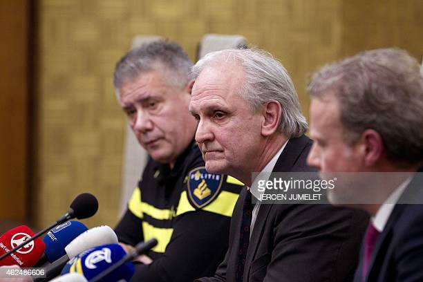 Dutch police chief Andre Wielandt Mayor Pieter Broertjes and Chief Prosecutor Johan Bac hold a press conference in Hilversum on January 29 after an...