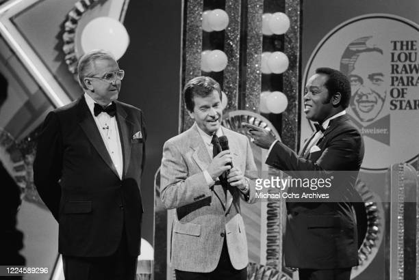 From left to right, Ed McMahon, Dick Clark and singer Lou Rawls during the Lou Rawls Parade of Stars, USA, circa 1985.