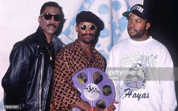 From left to right Eddie Murphy John Singleton and Ice Cube during 1992 MTV Movie Awards at Walt Disney Studios in Burbank California United States...