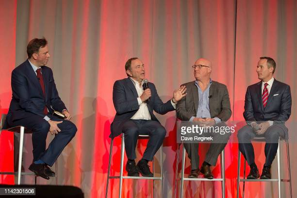 From left to right Elliotte Friedman Canadian sports journalist talks with Gary Bettman Commissioner of the National Hockey League Bill Daly Deputy...