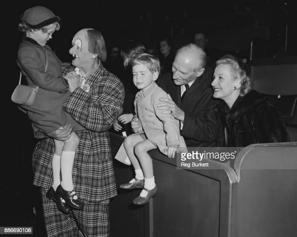 From left to right Emma Soames Coco the Clown Jeremy Soames Viscount Montgomery and American cabaret star Connie Moore at the preopening luncheon of...