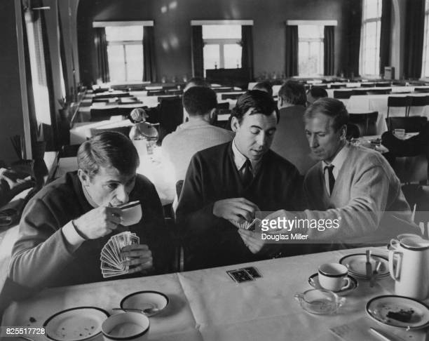 From left to right England footballers Roger Hunt Gordon Banks and Bobby Charlton enjoy a game of cards after a talk by the team manager at...