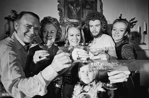 From left to right English actor Sir John Mills his wife Mary and their children Juliet Jonathan and Hayley celebrating the New Year in America 31st...