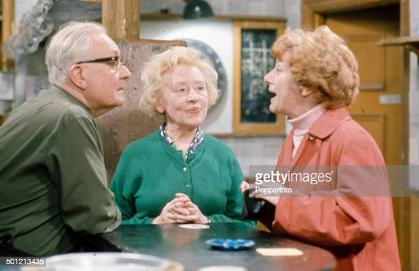 From left to right English actors Arthur Leslie as 'Jack Walker' Doris Speed as 'Annie Walker' and Jean Alexander as 'Hilda Ogden' pictured together...